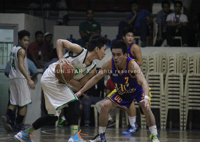 Jun Kent Manzo looks to pass the ball