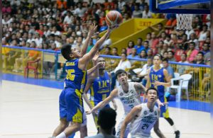 Michael Jay Gonzaga (left) scoops it in for UC in Game 1 of the Cesafi finals. (SunStar Photo/Amper Campaña)